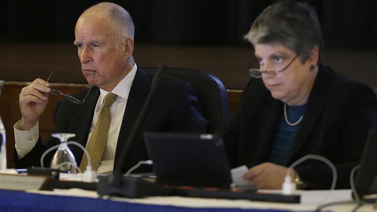 In this file photo from Wednesday, Jan. 22, 2014, Gov. Jerry Brown  and UC President Napolitano listen to speakers during a UC Board of Regents meeting in San Francisco. (AP Photo)