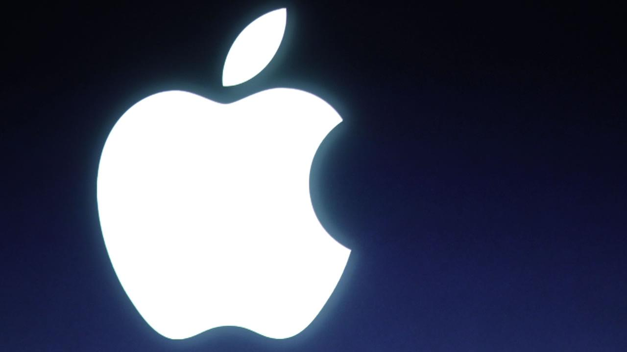 In this Tuesday, Oct. 4, 2011 file photo, an Apple logo is seen during an announcement at Apple headquarters in Cupertino, Calif.