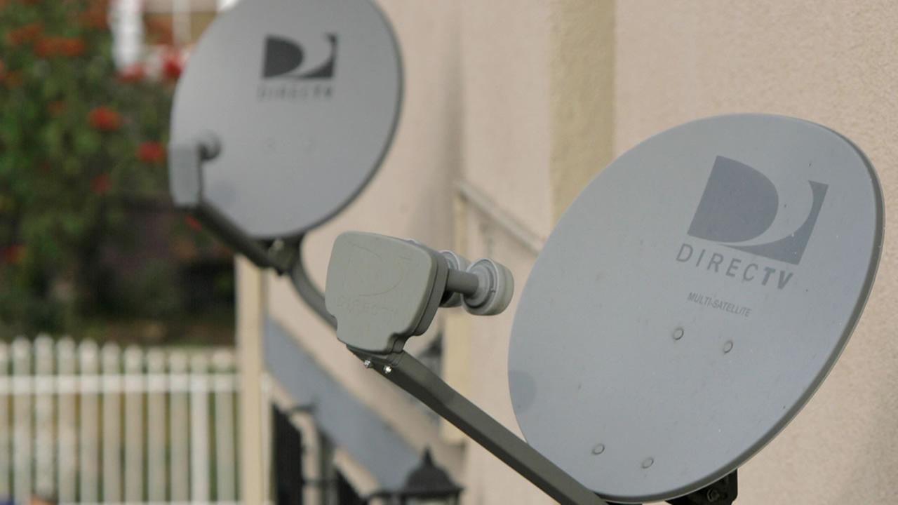 DirecTV satellite dishes. (AP Photo/Nick Ut, file)