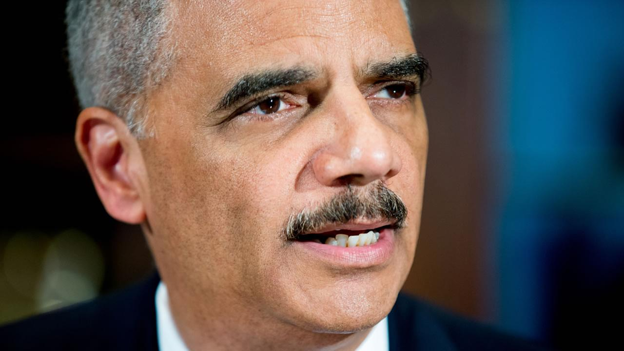 Attorney General Eric Holder announces six pilot cities for the National Initiative for Building Community Trust and Justice on Thursday, March 12, 2015.