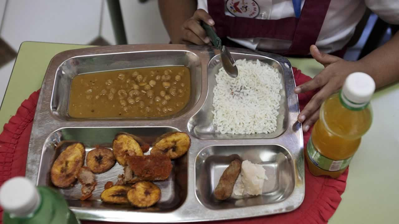 Lunches in Old Havana, Cuba, contain rice, a chicken croquette, a piece of taro root and yellow pea soup. The children provide their own drinks. <span class=meta>(AP Photo&#47;Franklin Reyes)</span>