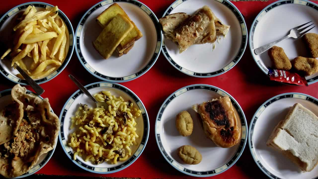 Kids usually bring a home-cooked meal to school in Pakistan, where school leaders check lunch boxes for junk food and admonish parents to keep things healthy.AP Photo/Anjum Naveed