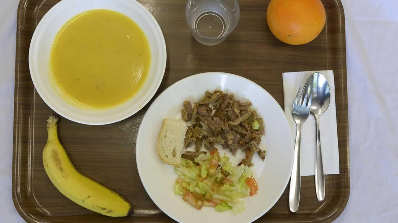 A school lunch at El Caminet del Besos kindergarten in Barcelona, Spain, is composed of cream of vegetable soup, pan-fried breast of veal with salad, a piece of bread, and fruit.AP Photo/Manu Fernandez