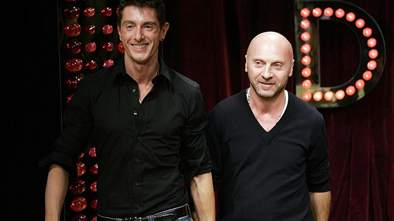 Fashion designers Domenico Dolce, right, and Stefano Gabbana acknowledge applause after presenting their D&G Fall/Winter 2005/2006 fashion collection, in Milan, Italy, Feb. 23, 2005. (AP Photo/Luca Bruno)