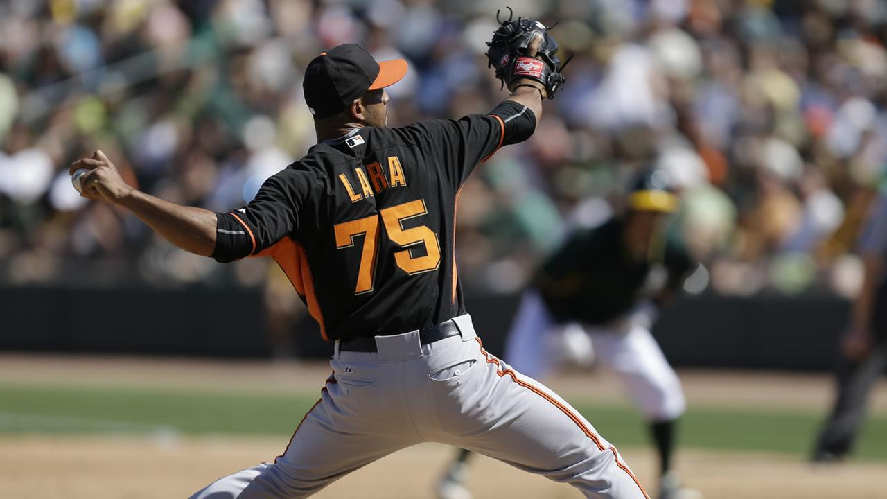 San Francisco Giants Braulio Lara works against the Oakland Athletics during a spring training exhibition baseball game Saturday, March 14, 2015, in Mesa, Ariz. (AP Photo)