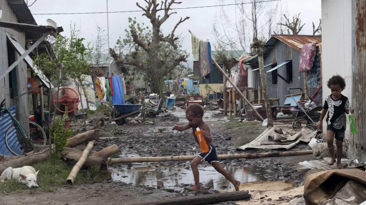 In this March 15, 2015 photo provided by UNICEF Pacific, young children move around debris as residents work to recover from Cyclone Pam in Mele village.(AP Photo/UNICEF Pacific)