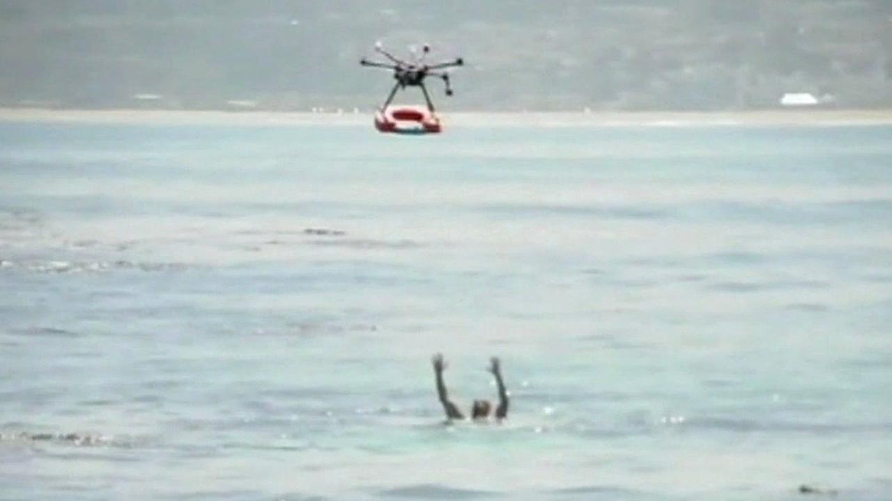 A drone prepares to drop a life preserver to a person drowning in Chile.