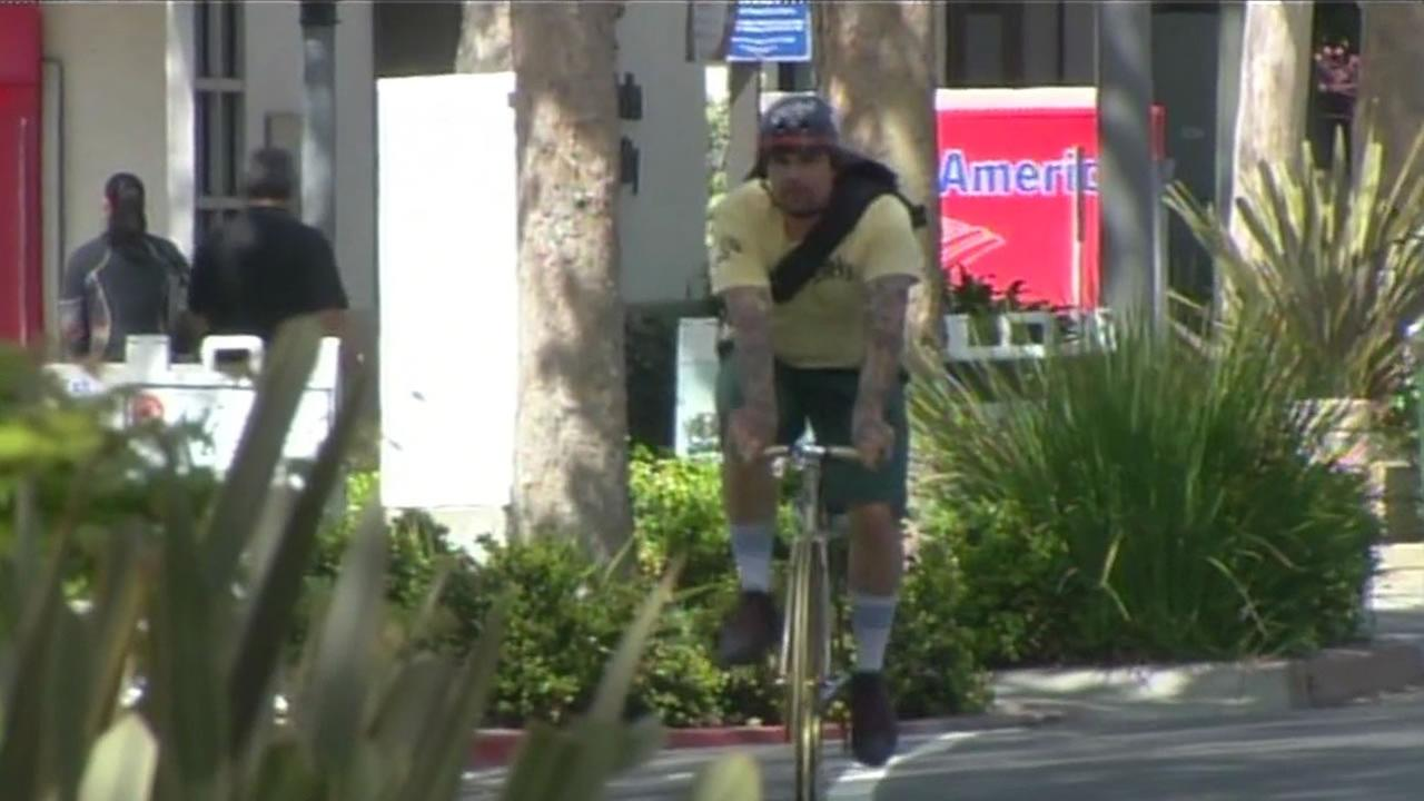 A bicyclist rides through San Jose streets