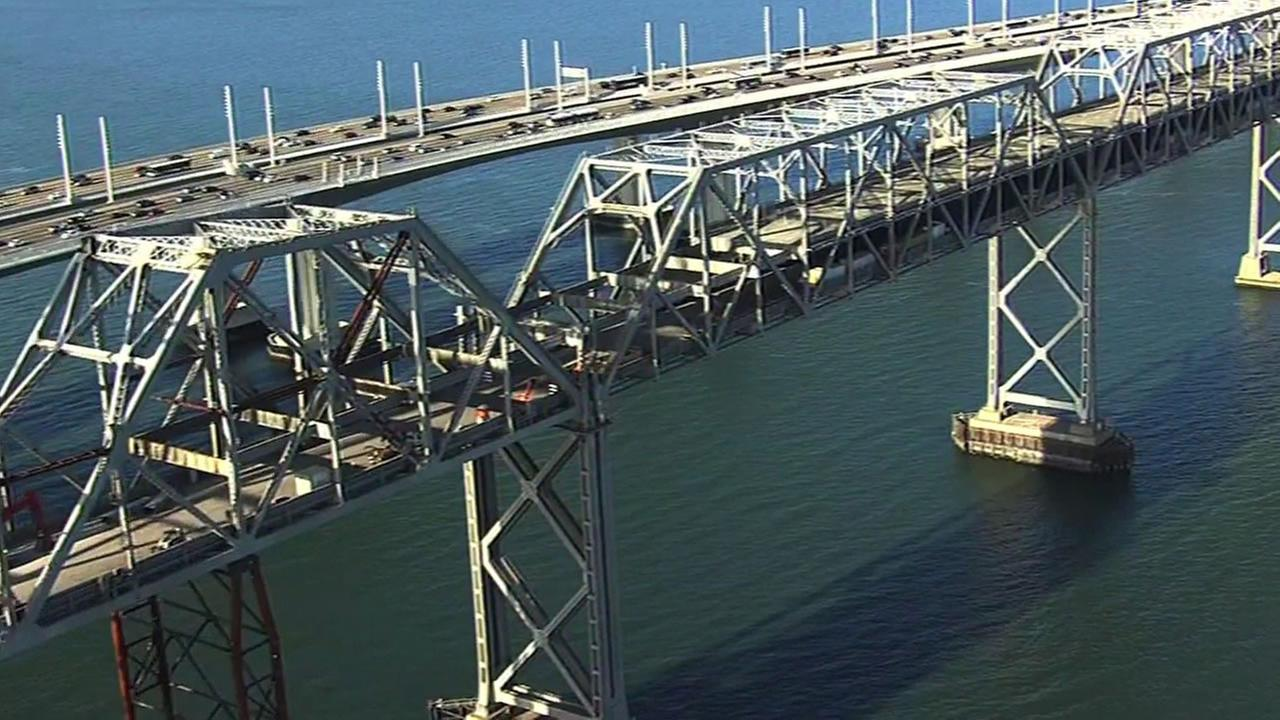 Workers are seen dismantling the old eastern span of the Bay Bridge.