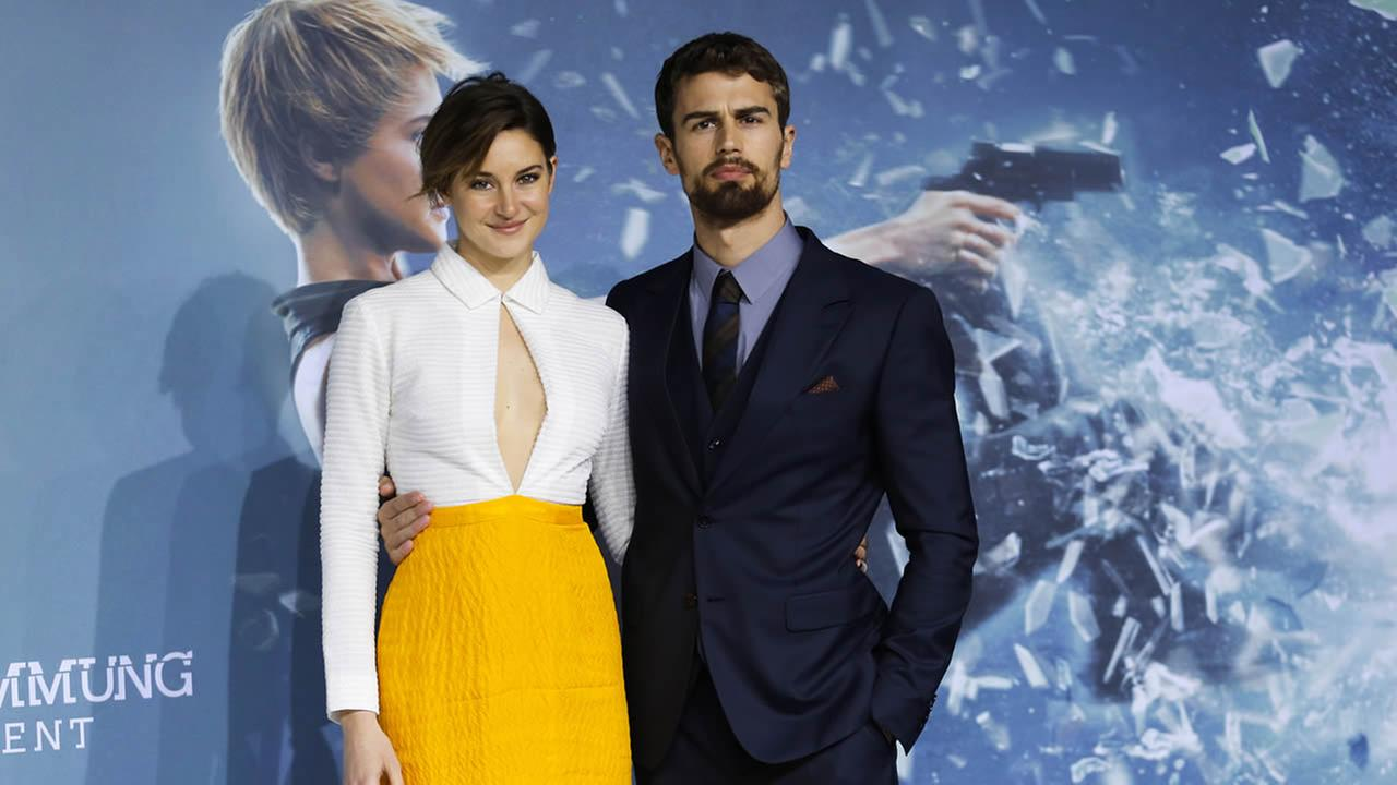 Actors Shailene Woodley, left, and Theo James arrive for the German premiere of the film Insurgent in Berlin, Friday, March 13, 2015. (AP Photo/Markus Schreiber)