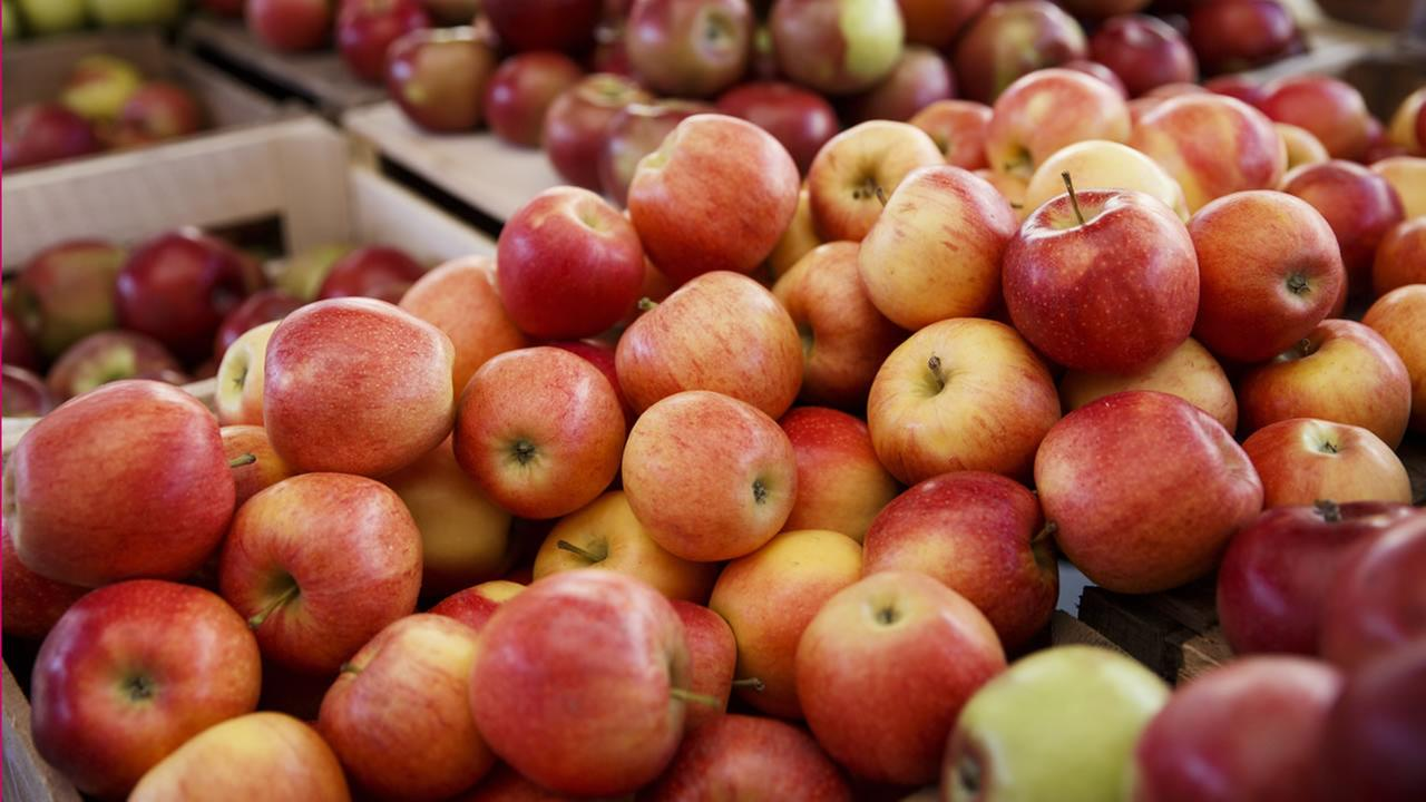 Apples and other healthful choices are displayed for sale at a Sunday morning farmers market in Arlington, Va., Oct. 5, 2014. (AP Photo/J. Scott Applewhite)