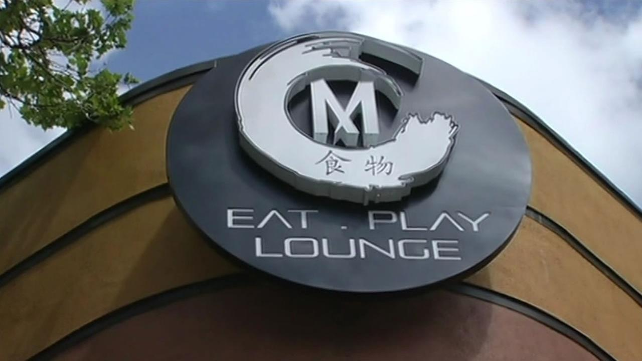 A sign for M Eat Play Lounge is seen in San Jose, Calif. on March 23, 2015.