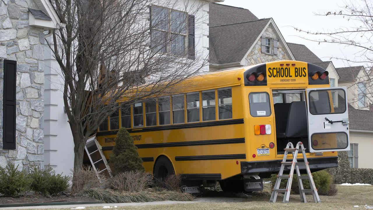 Shown is a school bus that crashed into a home Tuesday morning, March 24, 2015, in Blue Bell, Pa.(AP Photo/Matt Rourke)