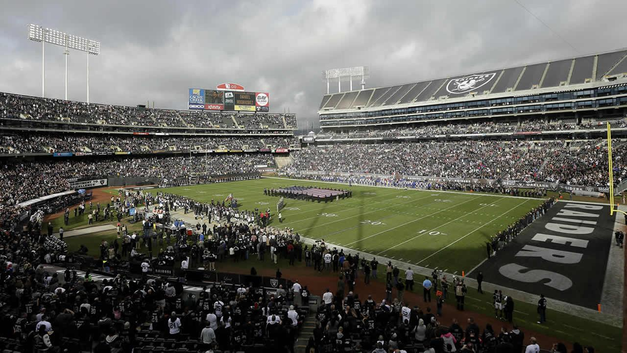 Fans watch from a view at the Coliseum in Oakland, during the first quarter of an NFL football game between the Oakland Raiders and the Buffalo Bills on Dec. 21, 2014 (AP Photo)