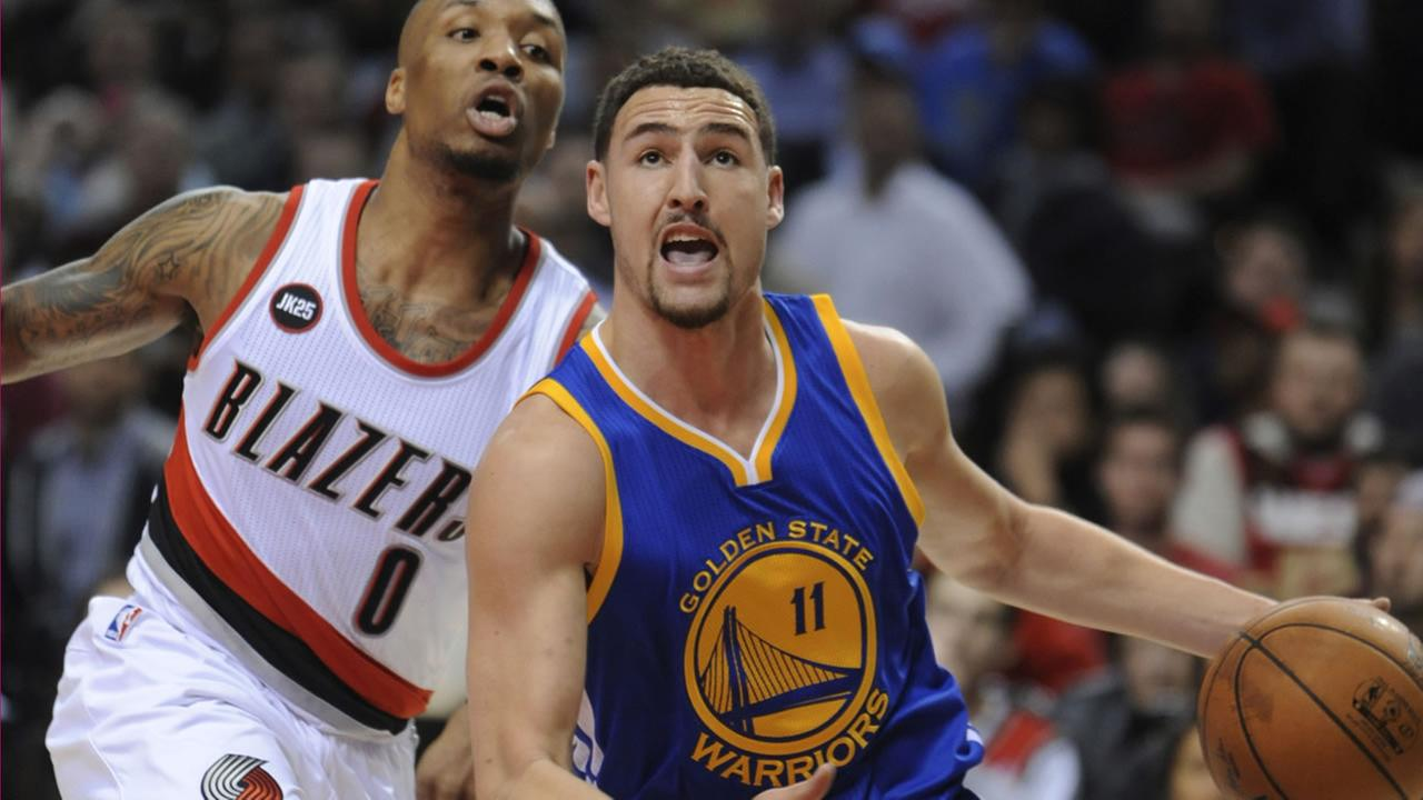 Golden State Warriors Klay Thompson (11) drives against Portland Trail Blazers Damian Lillard (0) in Portland, Ore., Tuesday, March 24, 2015. (AP Photo/Greg Wahl-Stephens)