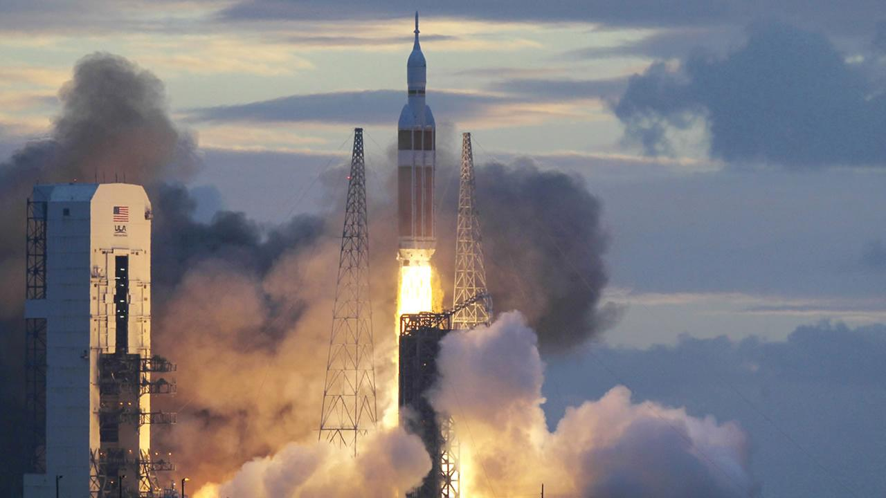 A NASA Orion capsule on top of a Delta IV rocket lifts off on its first unmanned orbital test flight from Complex 37 B at the Cape Canaveral Air Force Station Friday, Dec. 5, 2014.