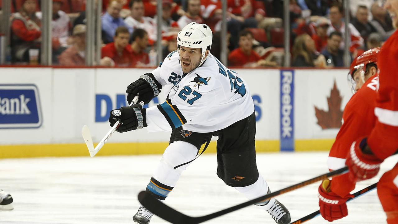 San Jose Sharks defenseman Scott Hannan (27) shoots against the Detroit Red Wings