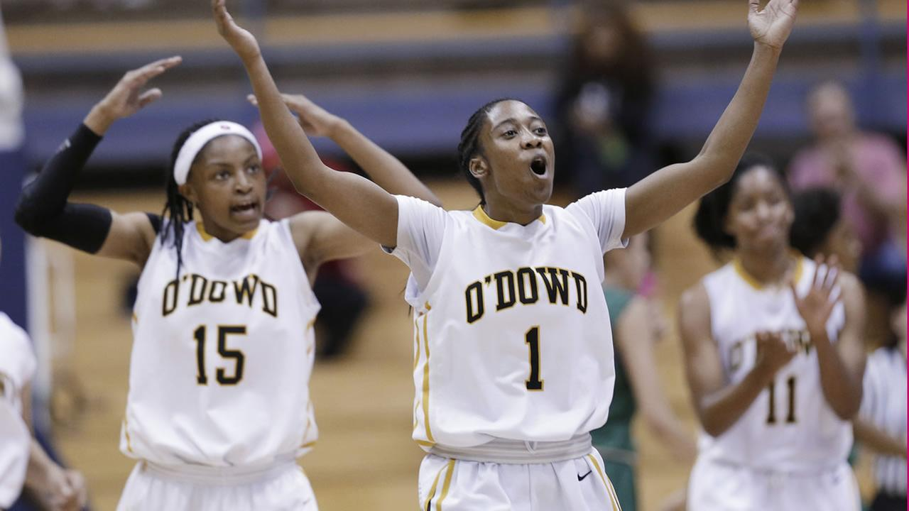 Bishop ODowds Asha Thomas (1) celebrates with Aisia Robertson (15) after Bishop ODowd took a lead against Brea Olinda in the girls Division 3 CIF basketball championships,