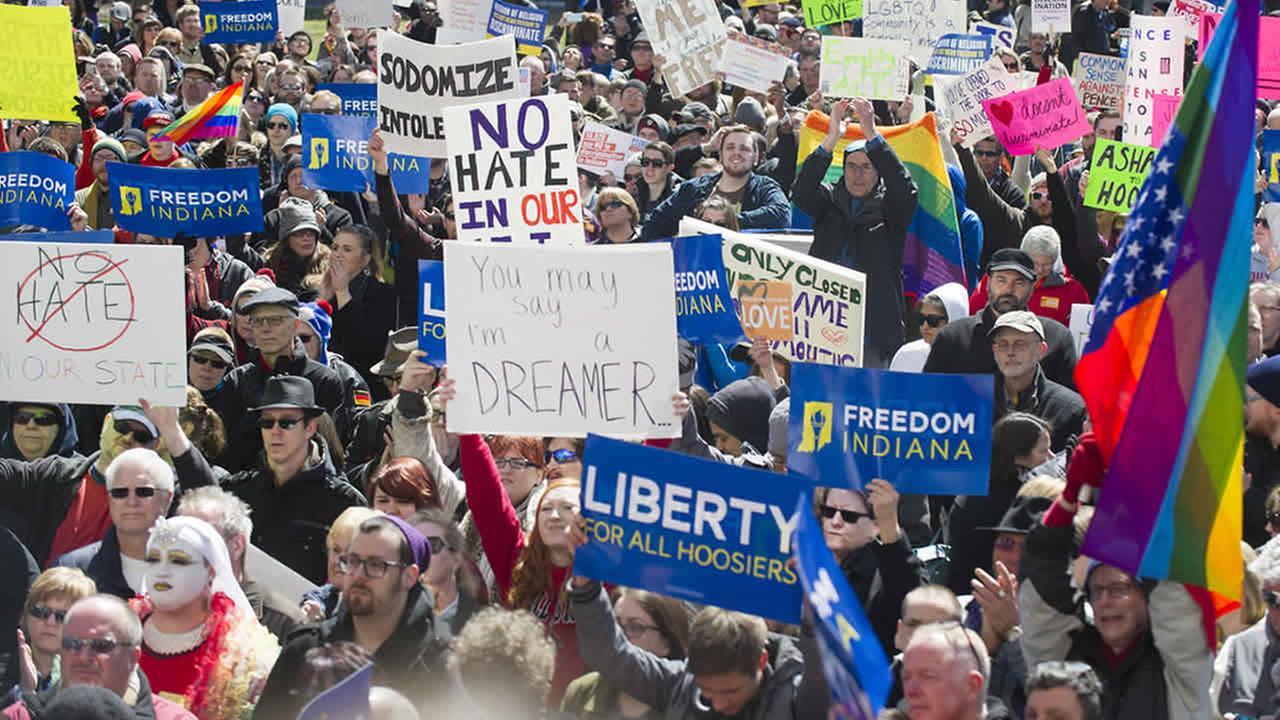 Thousands gather on the lawn of the Indiana State House to rally against the Religious Freedom Restoration Act on March 28, 2015. (AP Photo/Doug McSchooler)