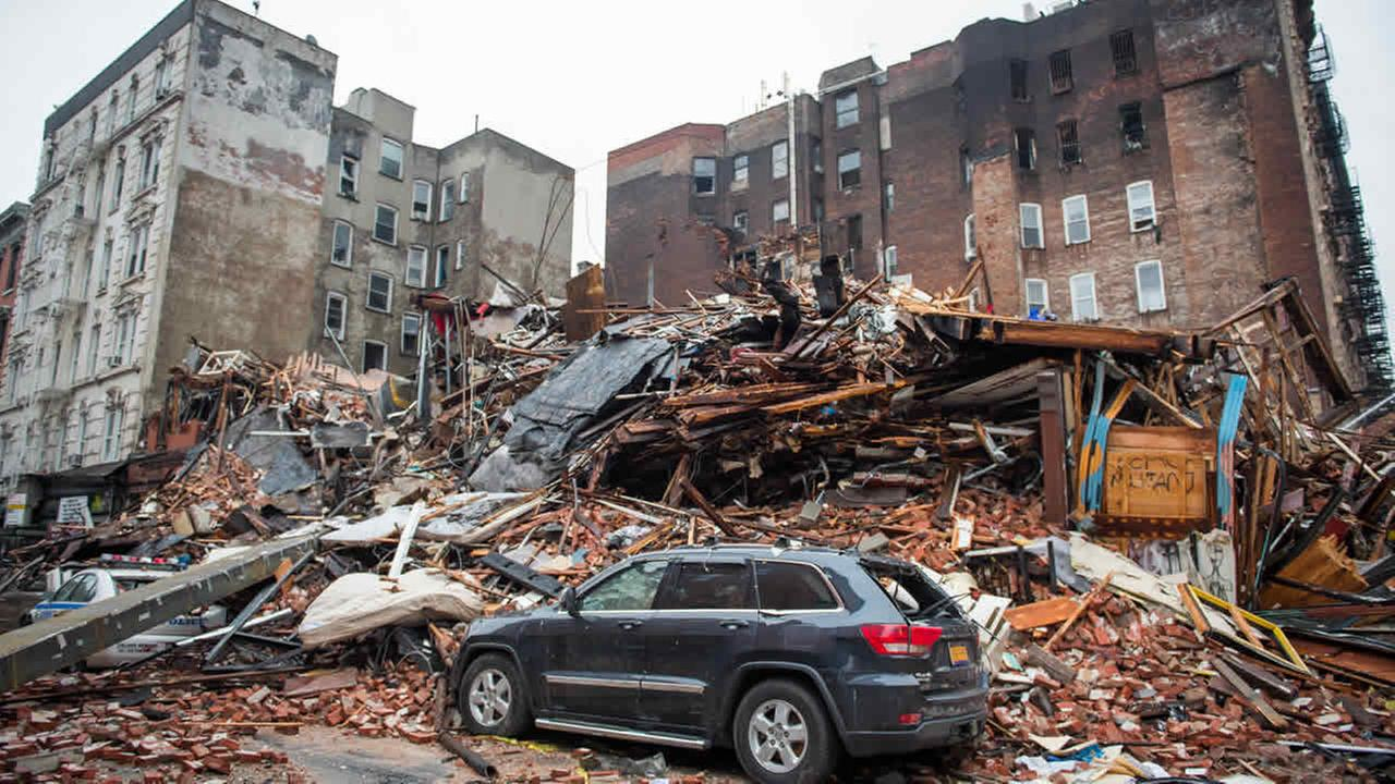 A pile of debris remains at the site of a building explosion in the East Village neighborhood of New York, Friday, March 27, 2015. (AP Photo/The New York Times, Nancy Borowick, Pool)
