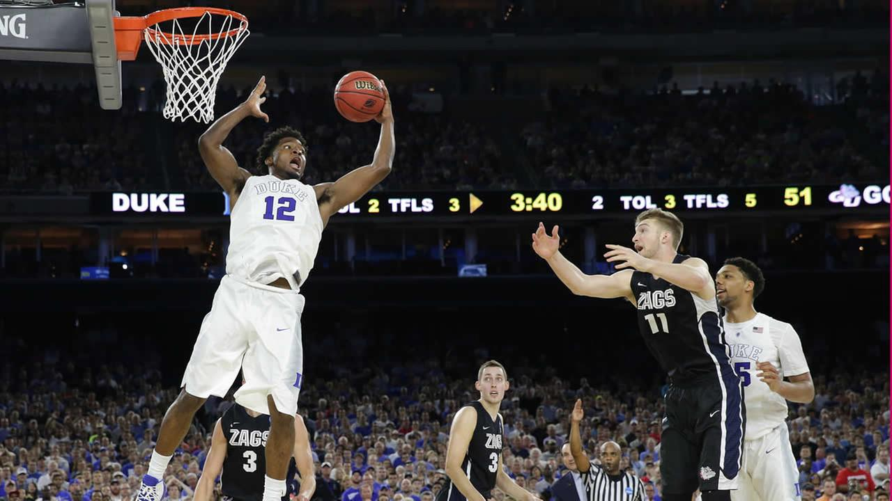 Dukes Justise Winslow grabs a rebound against Gonzaga during a college basketball regional final game in the NCAA Tournament March 29, 2015, in Houston.  (AP Photo/Charlie Riedel)