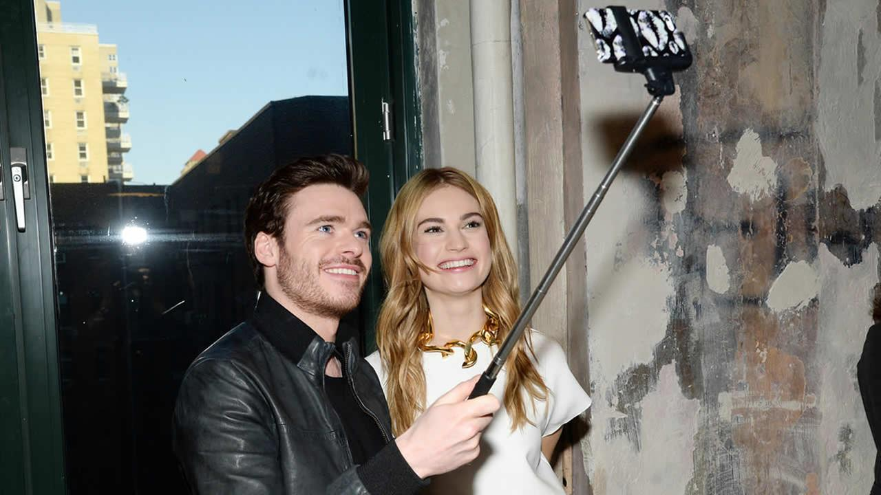 Actors Richard Madden and Lily James take a selfie while discussing their new film Cinderella at AOL Studios on March 9, 2015, in New York. (Photo by Evan Agostini/Invision/AP)