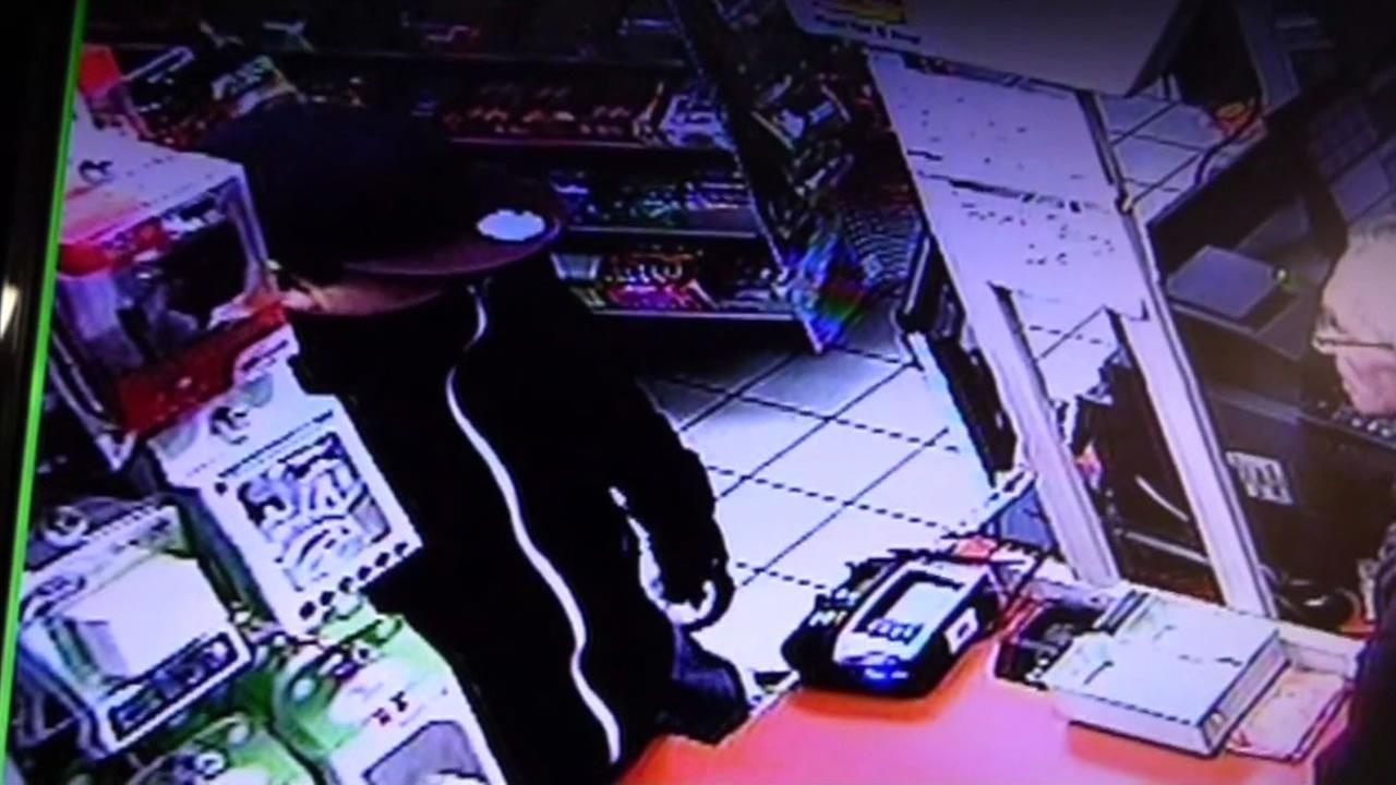 Masked man allegedly robbing a store in Petaluma
