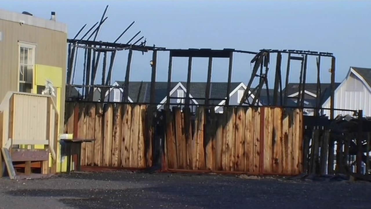 Officials are investigating a fire that destroyed four homes under construction in Dublin, Calif. on March 31, 2015.