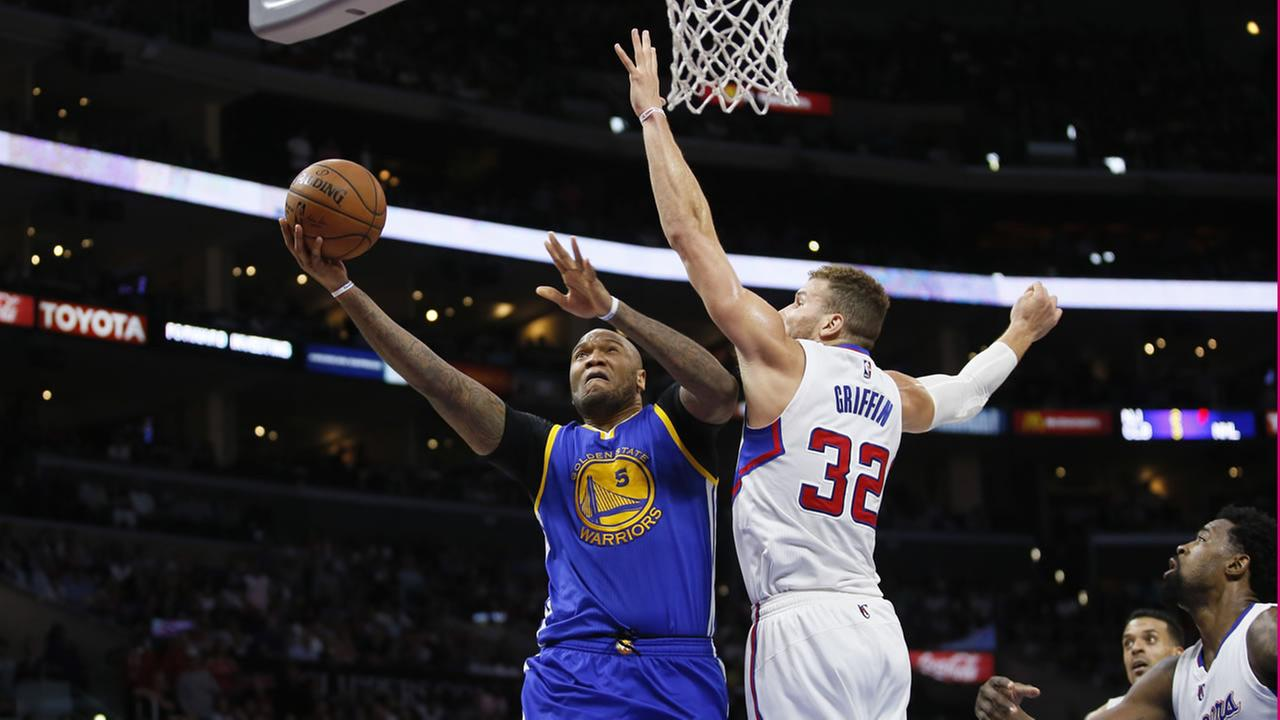 Golden State Warriors Marreese Speights, left, goes to the hoop while Los Angeles Clippers Blake Griffin defends