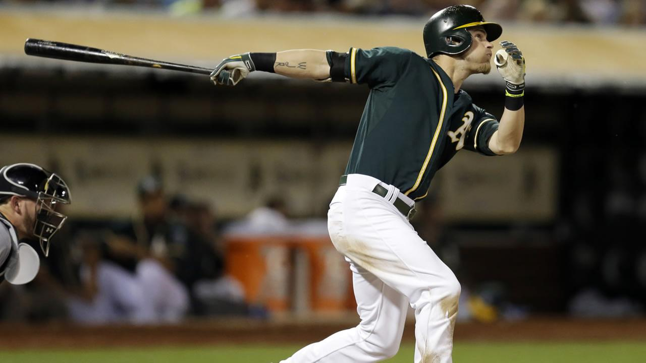 Oakland Athletics Josh Reddick swings for a two run home run.
