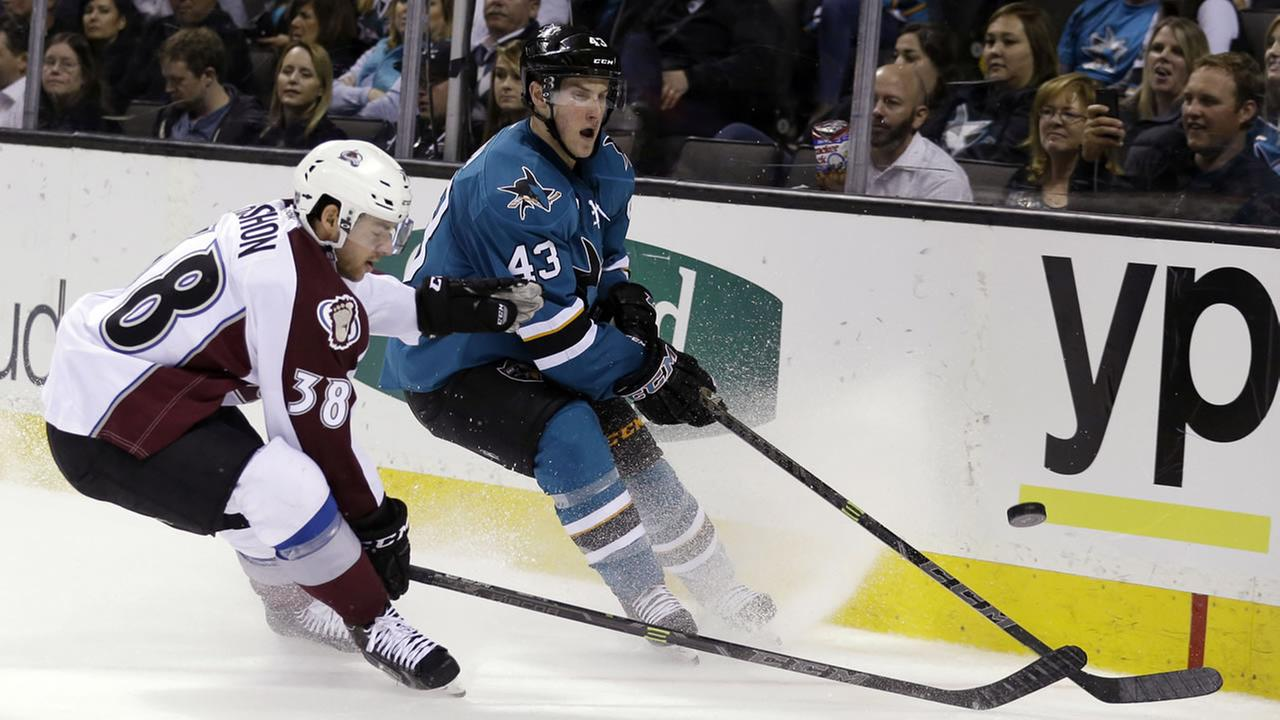 San Jose Sharks Taylor Fedun (43) works against Colorado Avalanches Joey Hishon