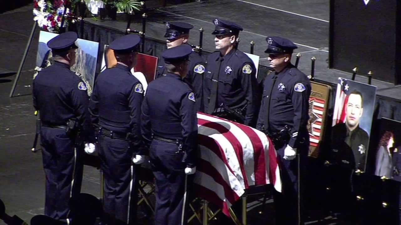 Officers salute the casket of fallen SJPD Officer Michael JohnsonKGO-TV
