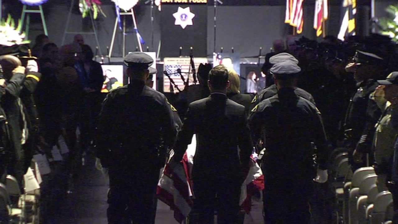 SJPD officers carry the casket of fallen Officer Michael JohnsonKGO-TV