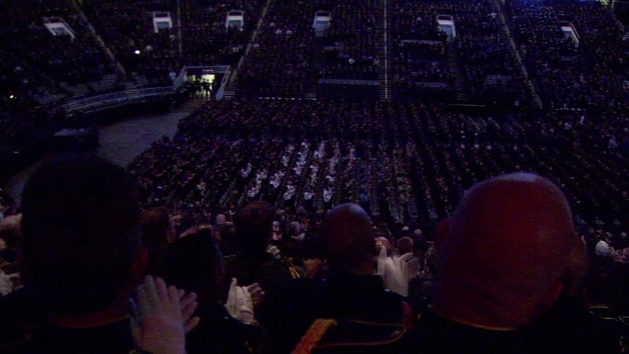 Thousands rose to their feet as Menlo Park Officer David Solis called for a standing ovation for fallen SJPD Officer JohnsonKGO-TV