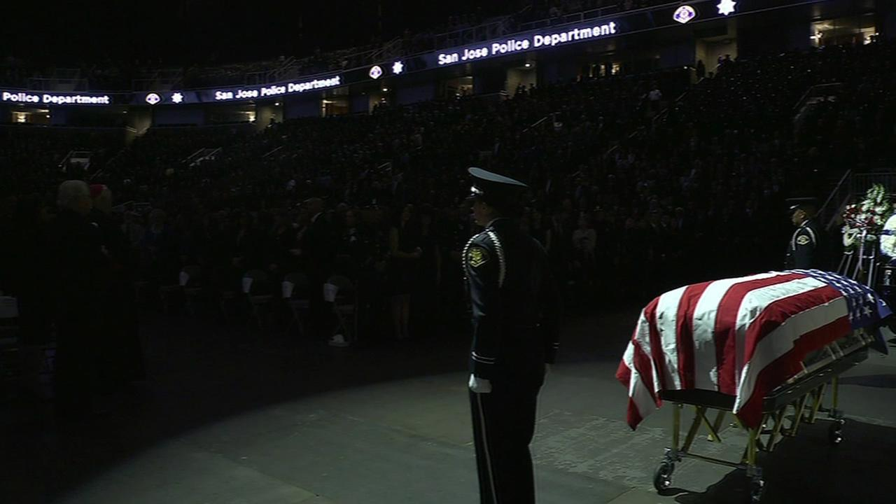 cop stands guard over casket