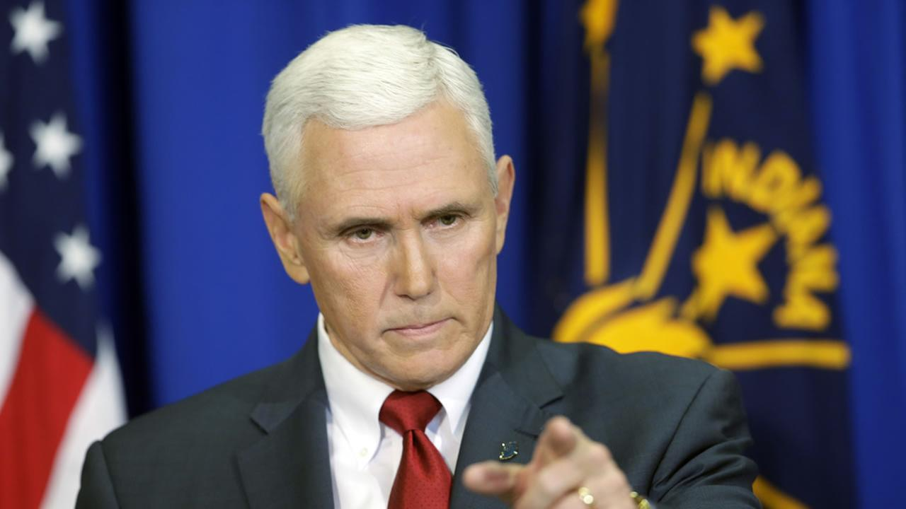 Indiana Gov. Mike Pence takes a question during a news conference, Tuesday, March 31, 2015, in Indianapolis.
