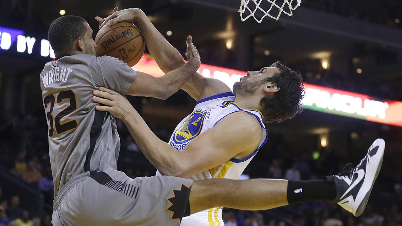 Phoenix Suns Brandan Wright, left, has his shot blocked by Golden State Warriors Andrew Bogut