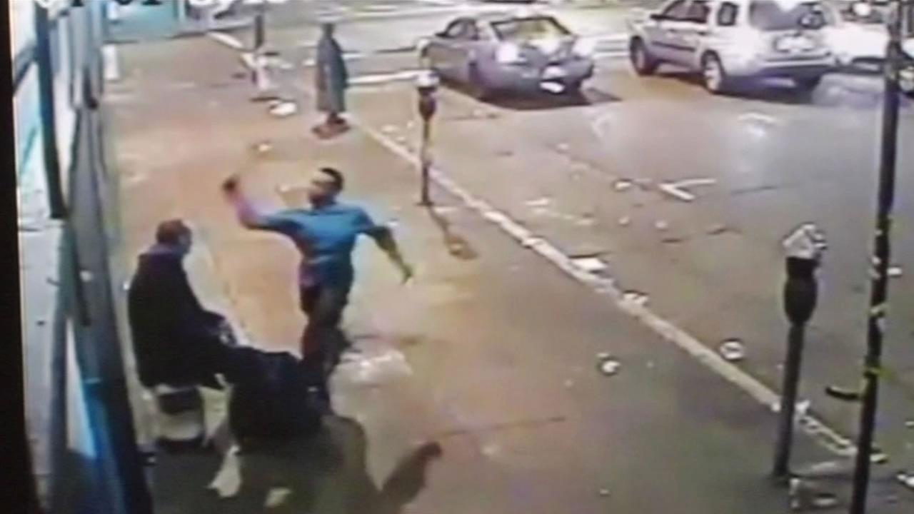 Surveillance video of man beaten by another man