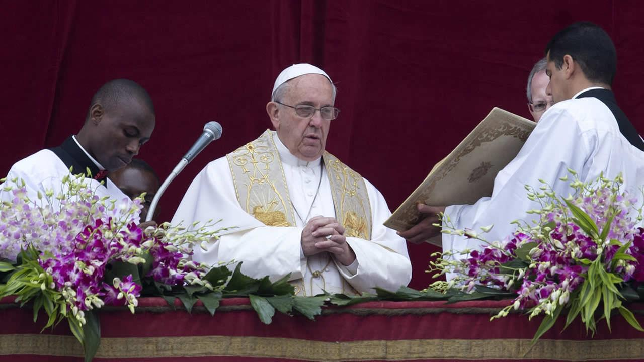 Pope Francis speaks before delivering the Urbi et Orbi (to the city and to the world) blessing at the end of the Easter Sunday Mass in St. Peters Square at the Vatican, April 5, 2015. (AP Photo/Andrew Medichini)