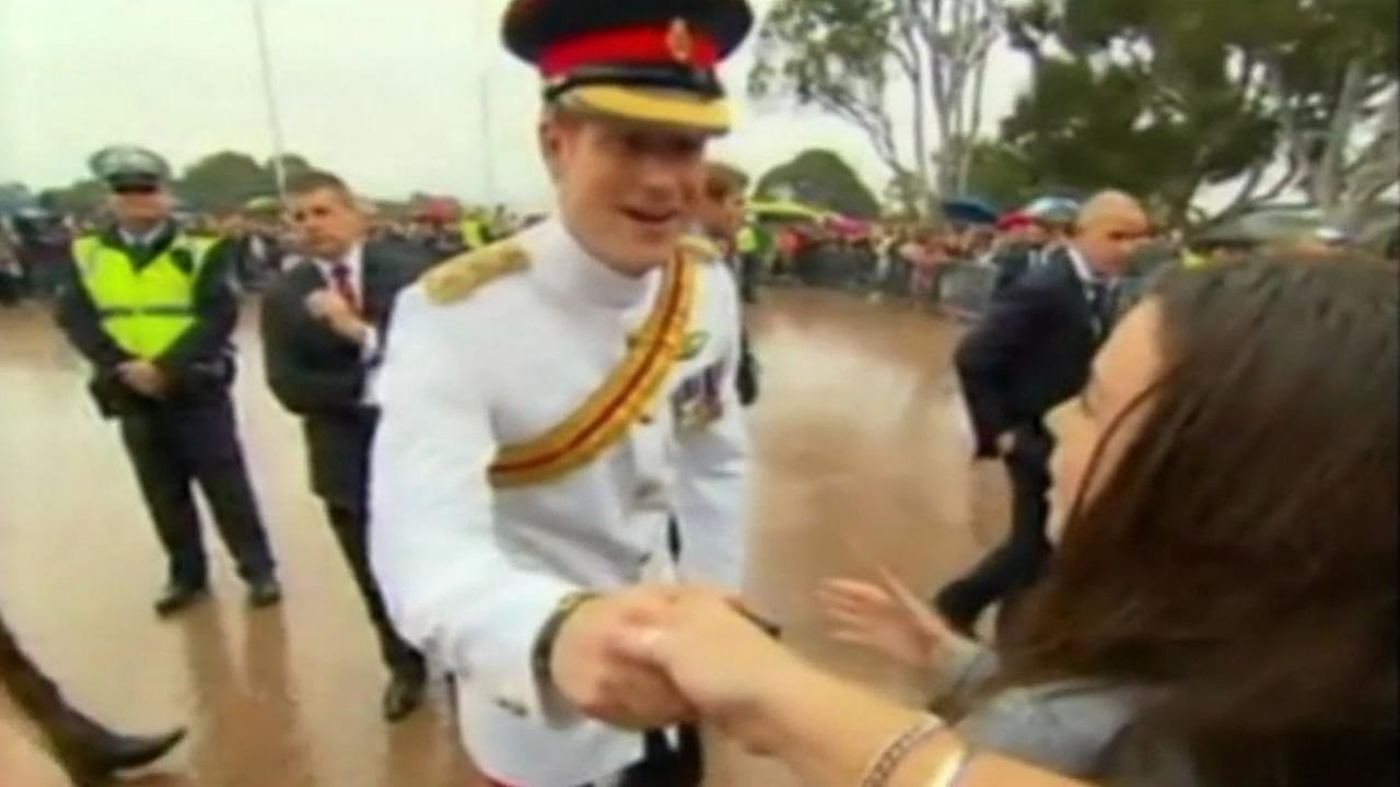 Britains Prince Harry shakes hands with fans in Canberra, Australia on April 6, 2015.