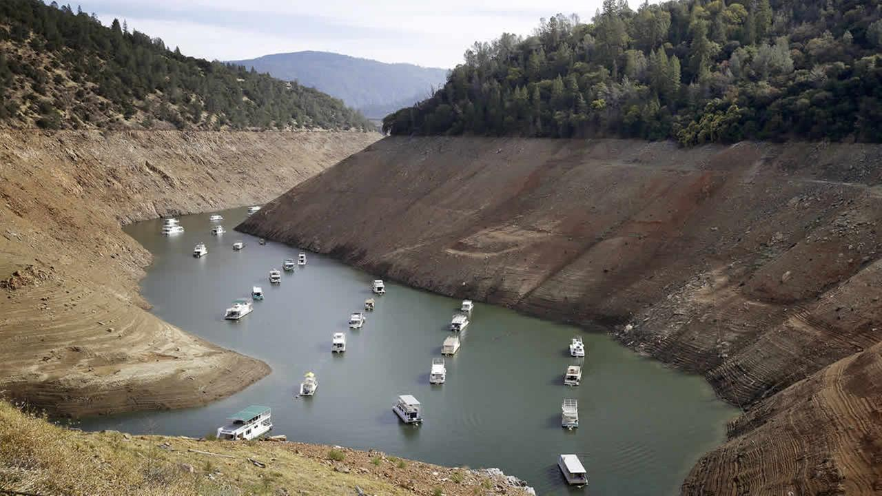 In this Thursday, Oct. 30, 2014, file photo, houseboats float in the drought-lowered waters of Oroville Lake near Oroville, Calif. (AP Photo/Rich Pedroncelli, File)