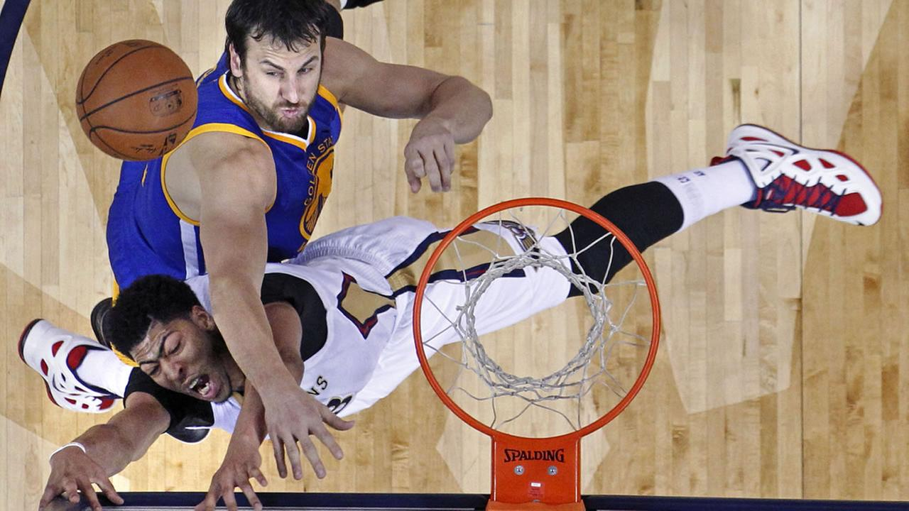 Golden State Warriors center Andrew Bogut, above, blocks a shot