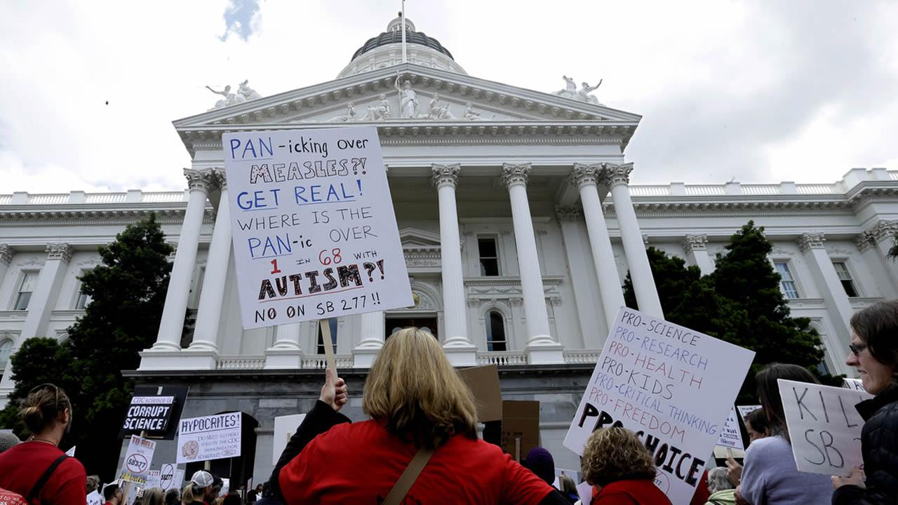Protesting against a measure requiring California schoolchildren to get vaccinated