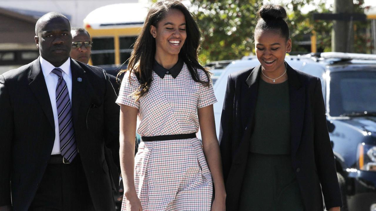Malia Obama, left, and sister Sasha Obama