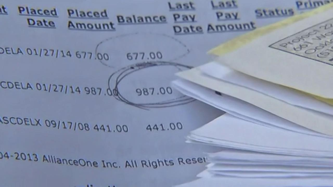 San Francisco resident Ron Coney shows the money he owes for traffic violations April 8, 2015.