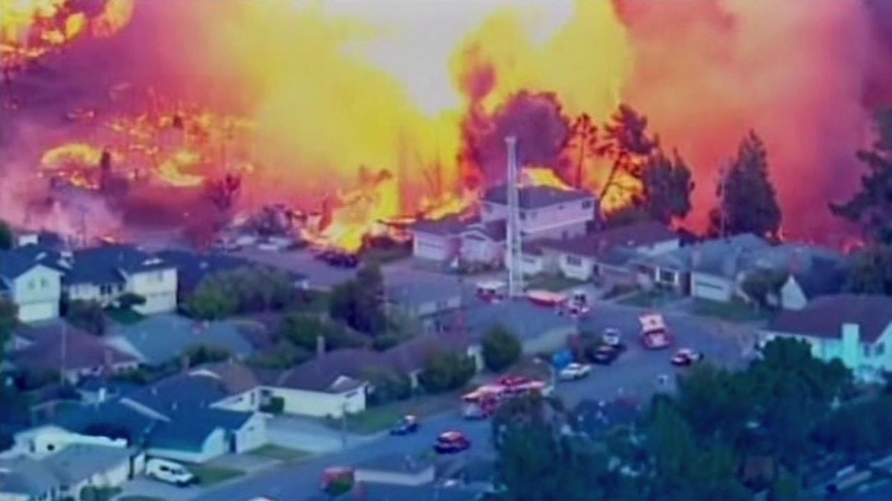 In this Sept. 9, 2010 file photo, a massive fire roars through a mostly residential neighborhood in San Bruno, Calif.