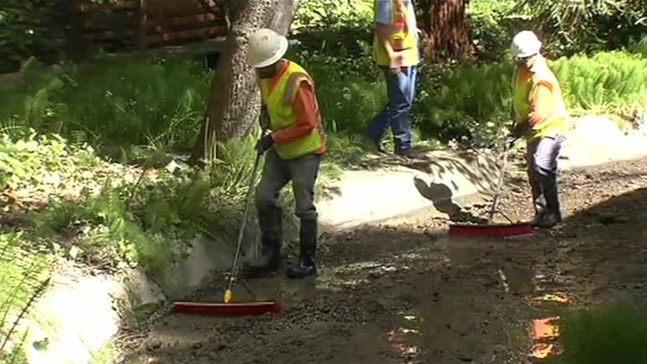 A massive cleanup is underway after a mistake by the East Bay Municipal Utility District allowed cement to flow into a creek in Oakland, Calif. on April 8, 2015.KGO-TV