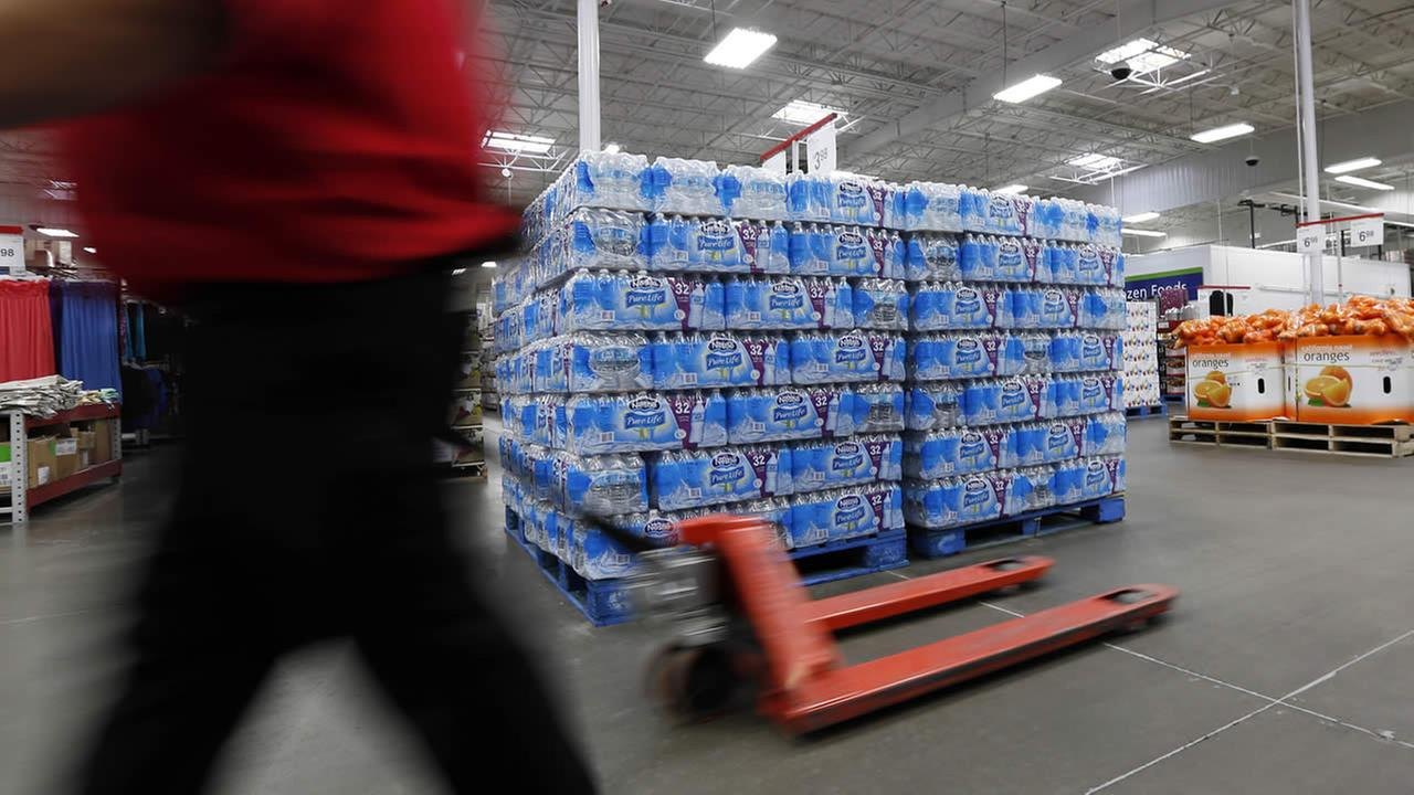 A customer walks past this Nestle Pure Life water display at this Jackson, Miss., Sams Club, Tuesday, March 5, 2013. (AP Photo/Rogelio V. Solis)