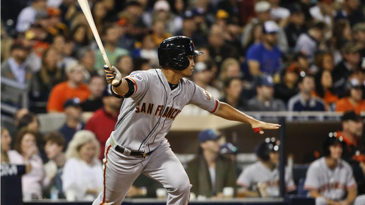 San Francisco Giants Nori Aoki watches his double head down the left field line against the San Diego Padres  on April 11, 2015 in San Diego. (AP Photo/Lenny Ignelzi)