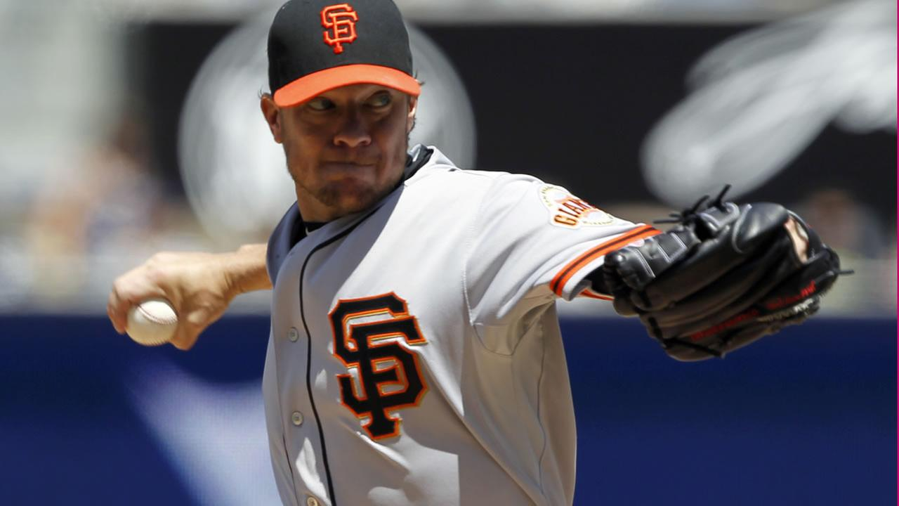 Giants starting pitcher Jake Peavy throws against the San Diego Padres during the first inning of a baseball game in San Diego, Calif., Sunday, April 12, 2015. (AP Photo)